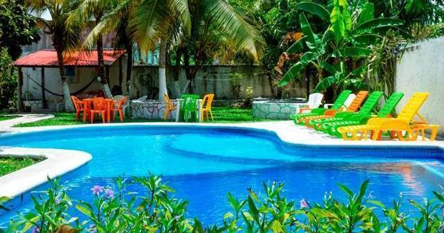 Make cheap reservations at a hostel like Amigos Hostel Cozumel